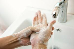 Fitness Facilities -An Image of a person washing their hands with soap